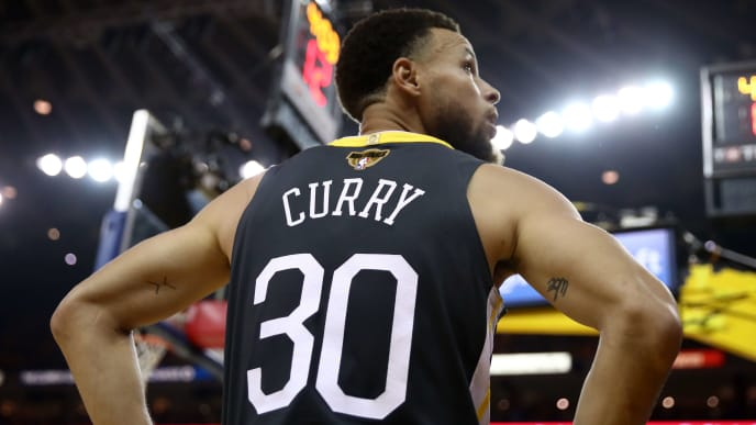 OAKLAND, CALIFORNIA - JUNE 13:  Stephen Curry #30 of the Golden State Warriors reacts against the Toronto Raptors in the first half during Game Six of the 2019 NBA Finals at ORACLE Arena on June 13, 2019 in Oakland, California. NOTE TO USER: User expressly acknowledges and agrees that, by downloading and or using this photograph, User is consenting to the terms and conditions of the Getty Images License Agreement. (Photo by Ezra Shaw/Getty Images)
