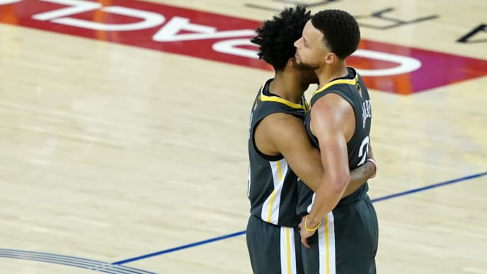 OAKLAND, CALIFORNIA - JUNE 13:  Quinn Cook #4 and Stephen Curry #30 of the Golden State Warriors embrace late in the game against the Toronto Raptors during Game Six of the 2019 NBA Finals at ORACLE Arena on June 13, 2019 in Oakland, California. NOTE TO USER: User expressly acknowledges and agrees that, by downloading and or using this photograph, User is consenting to the terms and conditions of the Getty Images License Agreement. (Photo by Thearon W. Henderson/Getty Images)