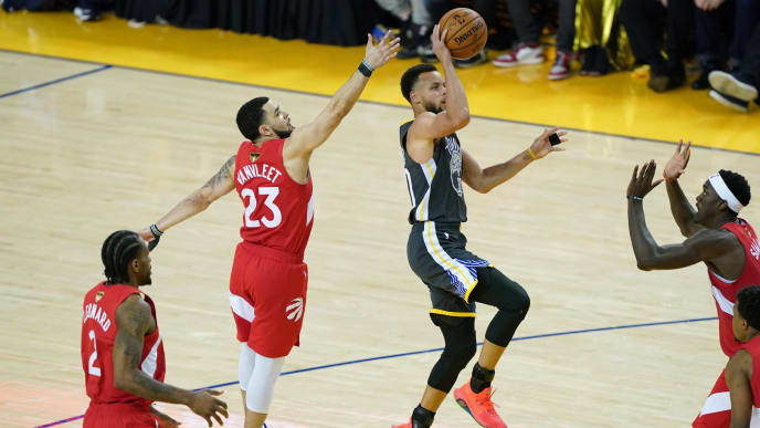 OAKLAND, CALIFORNIA - JUNE 13:  Stephen Curry #30 of the Golden State Warriors attempts a jump shot against the Toronto Raptors during Game Six of the 2019 NBA Finals at ORACLE Arena on June 13, 2019 in Oakland, California. NOTE TO USER: User expressly acknowledges and agrees that, by downloading and or using this photograph, User is consenting to the terms and conditions of the Getty Images License Agreement. (Photo by Thearon W. Henderson/Getty Images)