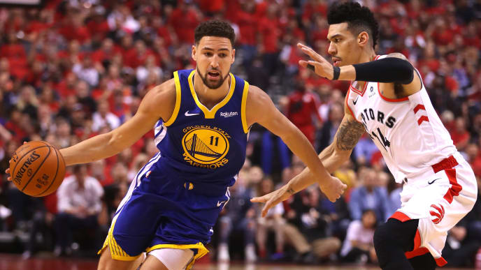 TORONTO, ONTARIO - JUNE 02: Klay Thompson #11 of the Golden State Warriors is defended by Danny Green #14 of the Toronto Raptors in the first half during Game Two of the 2019 NBA Finals at Scotiabank Arena on June 02, 2019 in Toronto, Canada.  NOTE TO USER: User expressly acknowledges and agrees that, by downloading and or using this photograph, User is consenting to the terms and conditions of the Getty Images License Agreement. (Photo by Gregory Shamus/Getty Images)