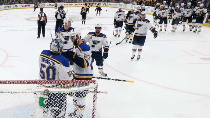 BOSTON, MASSACHUSETTS - JUNE 06:  Jordan Binnington #50 of the St. Louis Blues is congratulated by his teammates after their 2-1 win over the Boston Bruins in Game Five of the 2019 NHL Stanley Cup Final at TD Garden on June 06, 2019 in Boston, Massachusetts. (Photo by Bruce Bennett/Getty Images)