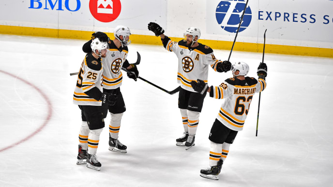 ST LOUIS, MISSOURI - JUNE 09:  Zdeno Chara #33 of the Boston Bruins is congratulated by his teammates after scoring a third period empty-net goal against the St. Louis Blues in Game Six of the 2019 NHL Stanley Cup Final at Enterprise Center on June 09, 2019 in St Louis, Missouri. (Photo by Ed Zurga/Getty Images)