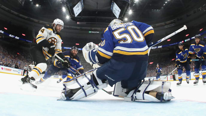 ST LOUIS, MISSOURI - JUNE 09: Jake DeBrusk #74 of the Boston Bruins moves in on Jordan Binnington #50 of the St. Louis Blues in Game Six of the 2019 NHL Stanley Cup Final at Enterprise Center on June 09, 2019 in St Louis, Missouri. (Photo by Bruce Bennett/Getty Images)