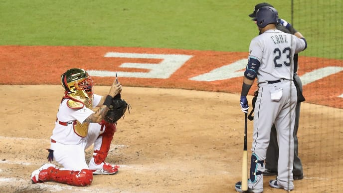 MIAMI, FL - JULY 11:  Yadier Molina #4 of the St. Louis Cardinals and the National League takes a photograph of Nelson Cruz #23 of the Seattle Mariners and the American League and umpire Joe West in the sixth inning during the 88th MLB All-Star Game at Marlins Park on July 11, 2017 in Miami, Florida.  (Photo by Rob Carr/Getty Images)