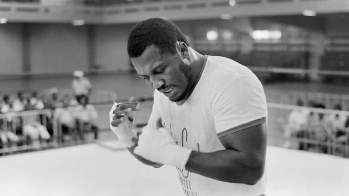 "A picture taken in January 1973 of US heavyweight boxing champion Joe Frazier during a training in Kingston before his match against George Foreman.Joe Frazier, the former undisputed heavyweight champ famed for his epic fights against Muhammad Ali, died on November 7, 2011 after a brief but brave battle with liver cancer. He was 67.  The family issued a statement confirming Frazier's death late Monday night.    The boxing icon won an Olympic gold medal in a brilliant career that spanned almost 20 years but he was best known for fighting Ali in a famed 1970s trilogy of bouts, including the epic ""Thrilla in Manila."" AFP PHOTO / FILES (Photo credit should read -/AFP/Getty Images)"