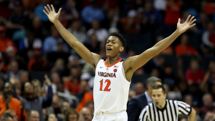 CHARLOTTE, NORTH CAROLINA - MARCH 14: De'Andre Hunter #12 of the Virginia Cavaliers reacts after a play against the North Carolina State Wolfpack during their game in the quarterfinal round of the 2019 Men's ACC Basketball Tournament at Spectrum Center on March 14, 2019 in Charlotte, North Carolina. (Photo by Streeter Lecka/Getty Images)
