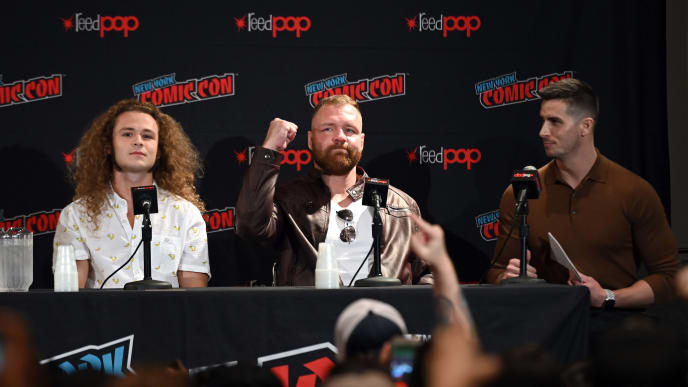 NEW YORK, NEW YORK - OCTOBER 04: (L-R) Jack Perry aka Jungle Boy, Jon Moxley, and moderator Mick Rouse attend the All Elite Wrestling panel during 2019 New York Comic Con at Jacob Javits Center on October 04, 2019 in New York City. (Photo by Noam Galai/Getty Images for WarnerMedia Company)