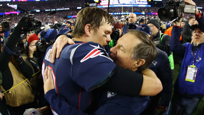 FOXBOROUGH, MA - JANUARY 21:  Tom Brady #12 of the New England Patriots celebrates with head coach Bill Belichick after winning the AFC Championship Game against the Jacksonville Jaguars at Gillette Stadium on January 21, 2018 in Foxborough, Massachusetts.  (Photo by Maddie Meyer/Getty Images)