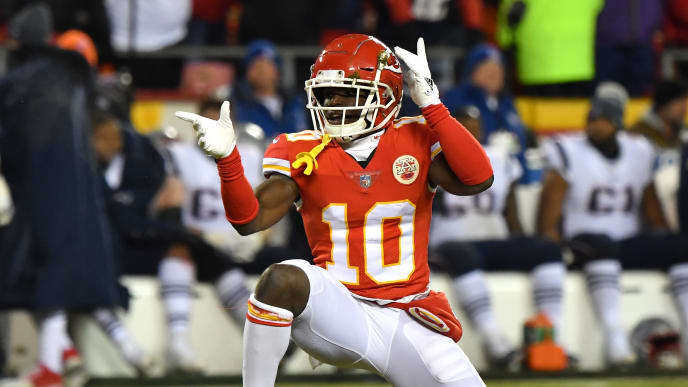 KANSAS CITY, MISSOURI - JANUARY 20: Tyreek Hill #10 of the Kansas City Chiefs reacts after a catch in the second quarter against the New England Patriots during the AFC Championship Game at Arrowhead Stadium on January 20, 2019 in Kansas City, Missouri. (Photo by Peter Aiken/Getty Images)