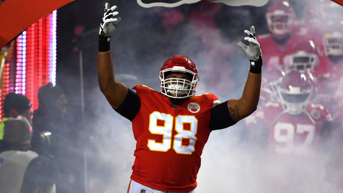 KANSAS CITY, MISSOURI - JANUARY 20: Xavier Williams #98 of the Kansas City Chiefs runs onto the field prior to the AFC Championship Game against the New England Patriots at Arrowhead Stadium on January 20, 2019 in Kansas City, Missouri. (Photo by Peter Aiken/Getty Images)