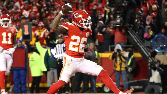 KANSAS CITY, MISSOURI - JANUARY 20: Damien Williams #26 of the Kansas City Chiefs celebrates after rushing for a 2-yard touchdown in the fourth quarter against the New England Patriots during the AFC Championship Game at Arrowhead Stadium on January 20, 2019 in Kansas City, Missouri. (Photo by Ronald Martinez/Getty Images)