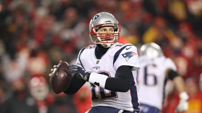 KANSAS CITY, MISSOURI - JANUARY 20: Tom Brady #12 of the New England Patriots throws a pass against the Kansas City Chiefs during the AFC Championship Game at Arrowhead Stadium on January 20, 2019 in Kansas City, Missouri. (Photo by Patrick Smith/Getty Images)