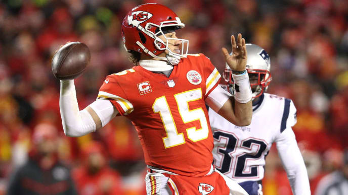 KANSAS CITY, MISSOURI - JANUARY 20: Patrick Mahomes #15 of the Kansas City Chiefs looks to pass in the second half against the New England Patriots during the AFC Championship Game at Arrowhead Stadium on January 20, 2019 in Kansas City, Missouri. (Photo by Patrick Smith/Getty Images)