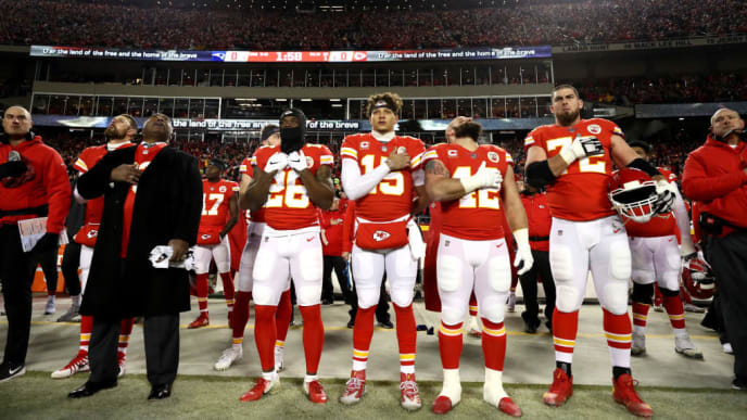 KANSAS CITY, MISSOURI - JANUARY 20: Patrick Mahomes #15 of the Kansas City Chiefs stands for the national anthem prior to the AFC Championship Game against the New England Patriots at Arrowhead Stadium on January 20, 2019 in Kansas City, Missouri. (Photo by Jamie Squire/Getty Images)