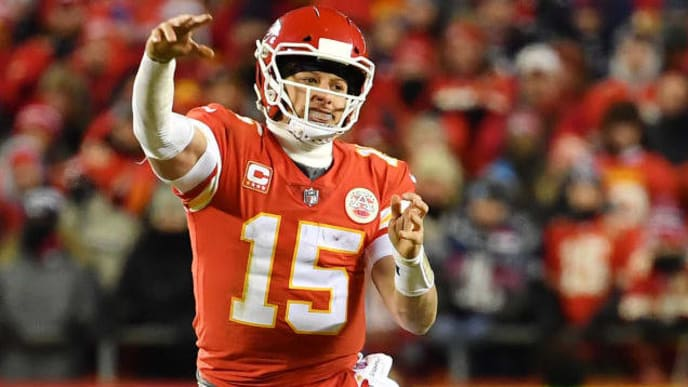 KANSAS CITY, MISSOURI - JANUARY 20: Patrick Mahomes #15 of the Kansas City Chiefs passes in the fourth quarter against the New England Patriots during the AFC Championship Game at Arrowhead Stadium on January 20, 2019 in Kansas City, Missouri. (Photo by Peter Aiken/Getty Images)