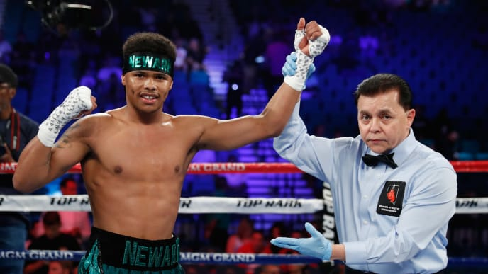 LAS VEGAS, NV - JUNE 09:  Referee Benjy Esteves (R) holds up the arm of Shakur Stevenson after he defeated Aelio Mesquita by TKO in the second round of their featherweight bout at MGM Grand Garden Arena on June 9, 2018 in Las Vegas, Nevada.  (Photo by Steve Marcus/Getty Images)