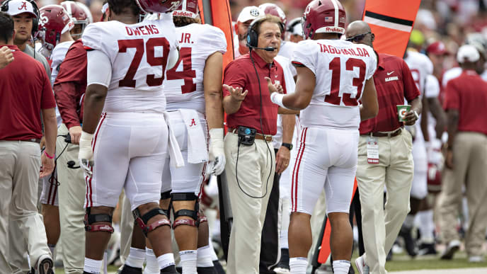FAYETTEVILLE, AR - OCTOBER 6:  Head Coach Nick Saban talks with Tua Tagovailoa #13 of the Alabama Crimson Tide as he comes off the field in the first quarter of a game against the Arkansas Razorbacks at Razorback Stadium on October 6, 2018 in Tuscaloosa, Alabama.  The Crimson Tide defeated the Razorbacks 65-31.  (Photo by Wesley Hitt/Getty Images)