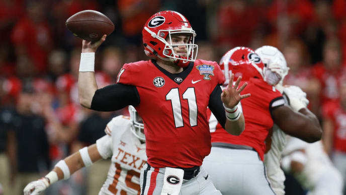 NEW ORLEANS, LOUISIANA - JANUARY 01:  Jake Fromm #11 of the Georgia Bulldogs drops bak to pass against the Texas Longhorns during the first half of the Allstate Sugar Bowl at the Mercedes-Benz Superdome on January 01, 2019 in New Orleans, Louisiana. (Photo by Sean Gardner/Getty Images)