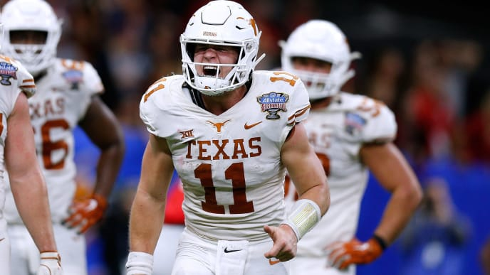 NEW ORLEANS, LOUISIANA - JANUARY 01: Sam Ehlinger #11 of the Texas Longhorns celebrates a touchdown during the second half of the Allstate Sugar Bowl against the Georgia Bulldogs at the Mercedes-Benz Superdome on January 01, 2019 in New Orleans, Louisiana. (Photo by Jonathan Bachman/Getty Images)