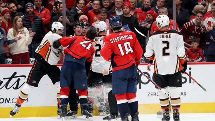 WASHINGTON, DC - NOVEMBER 18: Erik Gudbranson #6 of the Anaheim Ducks punches Garnet Hathaway #21 of the Washington Capitals in the second period at Capital One Arena on November 18, 2019 in Washington, DC. (Photo by Rob Carr/Getty Images)