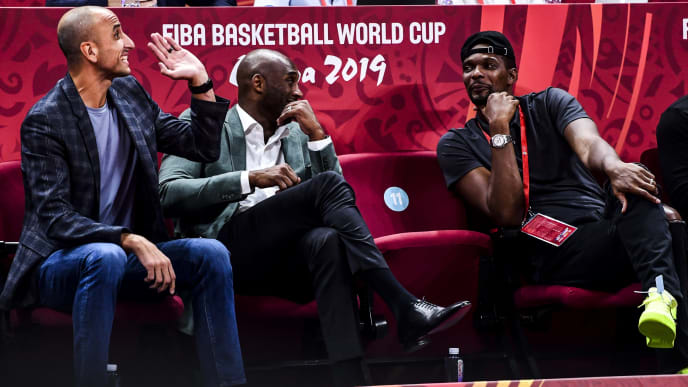 BEIJING, CHINA - SEPTEMBER 13:  Manu Ginobili,  Kobe Bryant and Chris Bosh talks to each other during the semi final march between Argentina and France of 2019 FIBA World Cup at the Cadillac Arena on September 13, 2019 in Beijing, China.  (Photo by Di Yin/Getty Images)