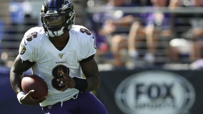 BALTIMORE, MARYLAND - SEPTEMBER 15: Quarterback Lamar Jackson #8 of the Baltimore Ravens in action against the Arizona Cardinals during the second quarter at M&T Bank Stadium on September 15, 2019 in Baltimore, Maryland. (Photo by Patrick Smith/Getty Images)