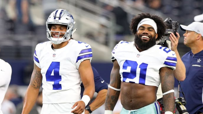 ARLINGTON, TX - AUGUST 26:  Dak Prescott #4 of the Dallas Cowboys and Ezekiel Elliott #21 of the Dallas Cowboys smile during warm ups before the preseason game against the Arizona Cardinals at AT&T Stadium on August 26, 2018 in Arlington, Texas.  (Photo by Richard Rodriguez/Getty Images)