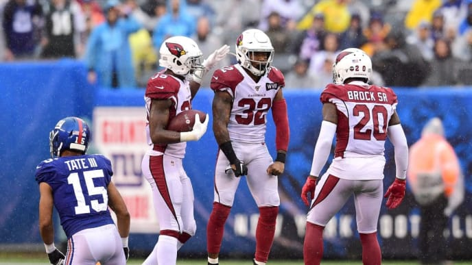 EAST RUTHERFORD, NEW JERSEY - OCTOBER 20: Deionte Thompson #35, Tramaine Brock #20 and Budda Baker #32 of the Arizona Cardinals celebrate during the second half of their game against the New York Giants at MetLife Stadium on October 20, 2019 in East Rutherford, New Jersey. (Photo by Emilee Chinn/Getty Images)
