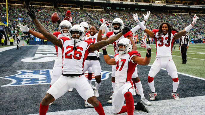 SEATTLE, WA - DECEMBER 30: Brandon Williams #26 and Zeke Turner #47 and other members of the Arizona Cardinals celebrate after tying the score in the third quarter against the Seattle Seahawks at CenturyLink Field on December 30, 2018 in Seattle, Washington. (Photo by Otto Greule Jr/Getty Images)