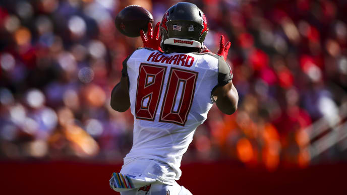 TAMPA, FL - NOVEMBER 10: O.J. Howard #80 of the Tampa Bay Buccaneers hauls in a pass from Jameis Winston #3 during the game against the Arizona Cardinals on November 10, 2019 at Raymond James Stadium in Tampa, Florida. (Photo by Will Vragovic/Getty Images)