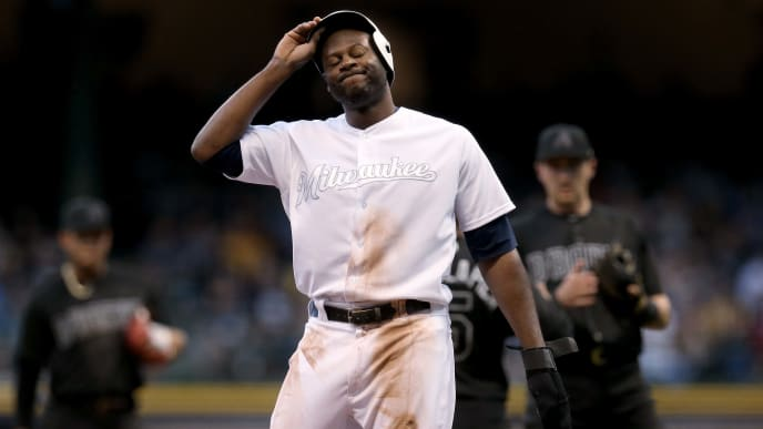 MILWAUKEE, WISCONSIN - AUGUST 24:  Lorenzo Cain #6 of the Milwaukee Brewers reacts after being tagged out in a run down in the third inning against the Arizona Diamondbacks at Miller Park on August 24, 2019 in Milwaukee, Wisconsin. Teams are wearing special color schemed uniforms with players choosing nicknames to display for Players' Weekend. (Photo by Dylan Buell/Getty Images)