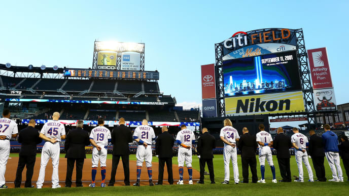 NEW YORK, NEW YORK - SEPTEMBER 11: First Responders and members of the New York Mets stand during a moment of silence in honor of the 18th anniversary of the Semptember 11th terror attacks in 2001 prior to the game against the Arizona Diamondbacks at Citi Field on September 11, 2019 in the Queens borough of New York City. (Photo by Mike Stobe/Getty Images)