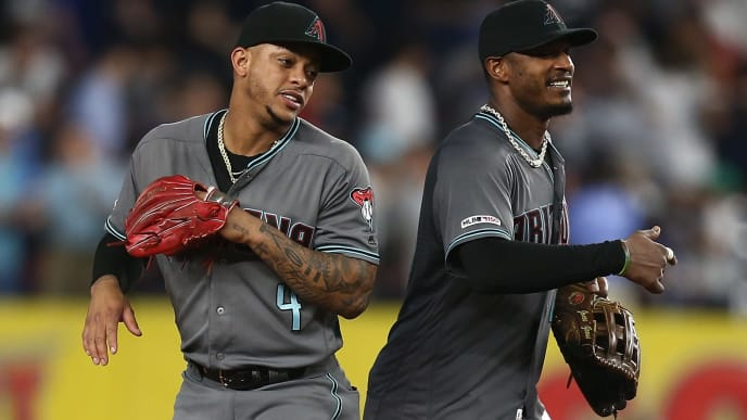 NEW YORK, NEW YORK - JULY 30: Ketel Marte #4 and Adam Jones #10 of the Arizona Diamondbacks celebrate after defeating the New York Yankees 4-2 at Yankee Stadium on July 30, 2019 in New York City. (Photo by Mike Stobe/Getty Images)