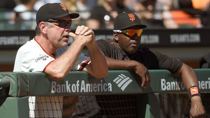 SAN FRANCISCO, CA - SEPTEMBER 19:  Manager Bruce Bochy #15 (L) and hitting coach Hensley Meulens #31 of the San Francisco Giants looks on from the dugout against the Arizona Diamondbacks in the top of the fifth inning at AT&T Park on September 19, 2015 in San Francisco, California.  (Photo by Thearon W. Henderson/Getty Images)
