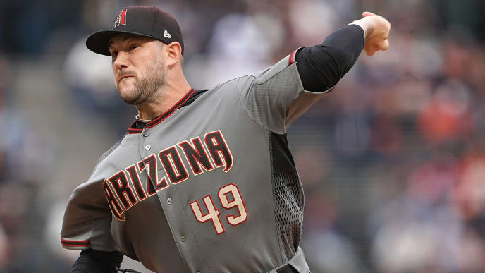 SAN FRANCISCO, CA - JUNE 27:  Alex Young #49 of the Arizona Diamondbacks pitches in his Major League debut against the San Francisco Giants in the bottom of the first inning at Oracle Park on June 27, 2019 in San Francisco, California.  (Photo by Thearon W. Henderson/Getty Images)