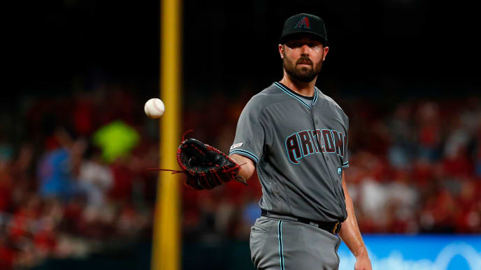 ST LOUIS, MO - JULY 12: Robbie Ray #38 of the Arizona Diamondbacks reacts after giving up a home run against the St. Louis Cardinals in the fifth inning at Busch Stadium on July 12, 2019 in St Louis, Missouri. (Photo by Dilip Vishwanat/Getty Images)