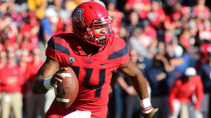 TUCSON, AZ - NOVEMBER 24:  Quarterback Khalil Tate #14 of the Arizona Wildcats looks to throw a pass as he rolls out against the Arizona State Sun Devils during the first half of the college football game at Arizona Stadium on November 24, 2018 in Tucson, Arizona.  (Photo by Ralph Freso/Getty Images)