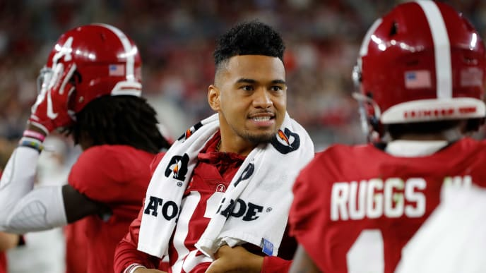 TUSCALOOSA, ALABAMA - OCTOBER 26:  Tua Tagovailoa #13 of the Alabama Crimson Tide reacts on the sidelines in the first half against the Arkansas Razorbacks with Henry Ruggs III #11 at Bryant-Denny Stadium on October 26, 2019 in Tuscaloosa, Alabama. (Photo by Kevin C. Cox/Getty Images)