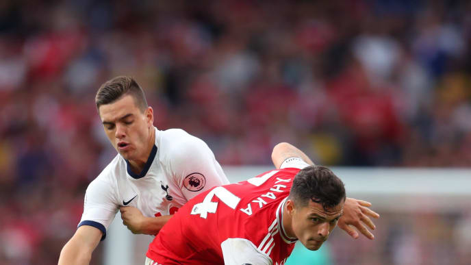 LONDON, ENGLAND - SEPTEMBER 01: Giovani Lo Celso of Tottenham Hotspur and Granit Xhaka of Arsenal during the Premier League match between Arsenal FC and Tottenham Hotspur at Emirates Stadium on September 01, 2019 in London, United Kingdom. (Photo by Catherine Ivill/Getty Images)
