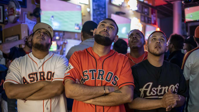 HOUSTON, TX - OCTOBER 29: Fans react to game 6 of the World Series between the Houston Astros and The Washington Nationals at Home Plate bar and grill near Minute Maid Park on October 29, 2019 in Houston, Texas. The Nationals won the game 7-2, forcing a game 7. (Photo by Sergio Flores/Getty Images)