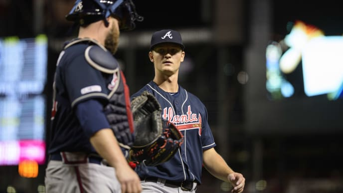 PHOENIX, ARIZONA - MAY 09: Mike Soroka (R) talks with Brian McCann #16 of the Atlanta Braves after pitching an inning against the Arizona Diamondbacks at Chase Field on May 09, 2019 in Phoenix, Arizona. (Photo by Jennifer Stewart/Getty Images)