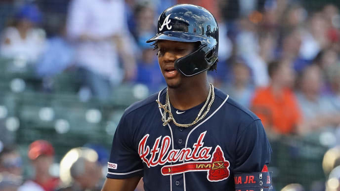 CHICAGO, ILLINOIS - JUNE 25: Ronald Acuna Jr. #13 of the Atlanta Braves celebrates his first pitch, lead-off home run in the 1st inning against the Chicago Cubs at Wrigley Field on June 25, 2019 in Chicago, Illinois. (Photo by Jonathan Daniel/Getty Images)