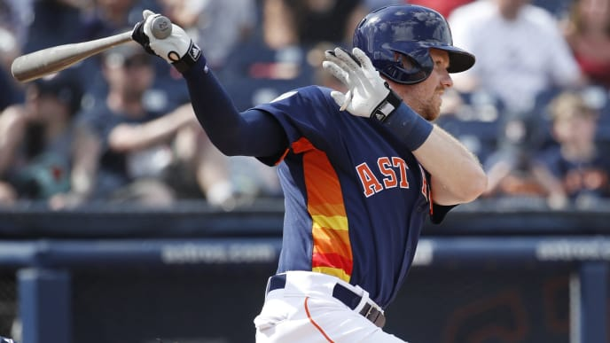 WEST PALM BEACH, FL - FEBRUARY 24: Derek Fisher #21 of the Houston Astros singles to right-center field to drive in a run in the third inning of a Grapefruit League spring training game against the Atlanta Braves at The Ballpark of the Palm Beaches on February 24, 2019 in West Palm Beach, Florida. (Photo by Joe Robbins/Getty Images)