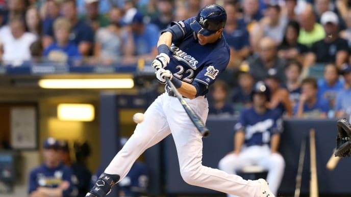 MILWAUKEE, WISCONSIN - JULY 15:  Christian Yelich #22 of the Milwaukee Brewers hits a single in the fourth inning against the Atlanta Braves against the Atlanta Braves at Miller Park on July 15, 2019 in Milwaukee, Wisconsin. (Photo by Dylan Buell/Getty Images)