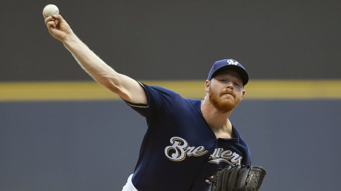 MILWAUKEE, WISCONSIN - JULY 16: Starting pitcher Brandon Woodruff #53 of the Milwaukee Brewers delivers the ball in the first inning against the Atlanta Braves at Miller Park on July 16, 2019 in Milwaukee, Wisconsin. (Photo by Quinn Harris/Getty Images)