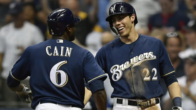 MILWAUKEE, WISCONSIN - JULY 16: Christian Yelich #22 of the Milwaukee Brewers congratulates Lorenzo Cain #6 of the Milwaukee Brewers for his home run in the sixth inning against the Atlanta Braves at Miller Park on July 16, 2019 in Milwaukee, Wisconsin. (Photo by Quinn Harris/Getty Images)