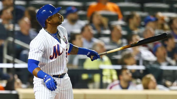 NEW YORK, NY - MAY 01:  Yoenis Cespedes #52 of the New York Mets connects on a solo home run in the sixth inning against the Atlanta Braves at Citi Field on May 1, 2018 in the Flushing neighborhood of the Queens borough of New York City.  (Photo by Mike Stobe/Getty Images)