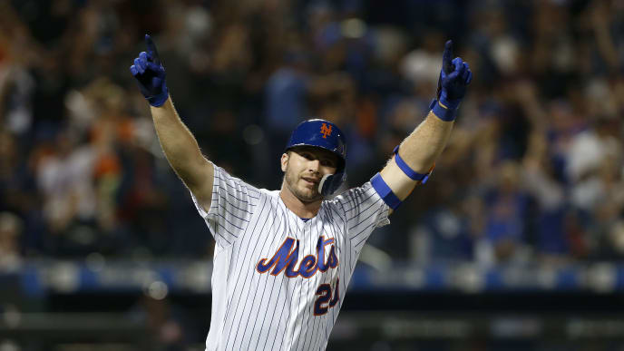 "NEW YORK, NEW YORK - SEPTEMBER 28:  Pete Alonso #20 of the New York Mets reacts after his third inning home run against the Atlanta Braves at Citi Field on September 28, 2019 in New York City. The home run was Alonso""s 53rd of the season, breaking Aaron Judge's rookie record. (Photo by Jim McIsaac/Getty Images)"