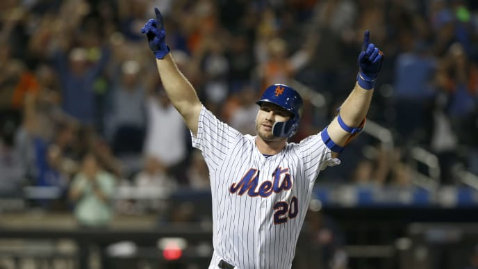 NEW YORK, NEW YORK - SEPTEMBER 28:   Pete Alonso #20 of the New York Mets celebrates his third inning home run against the Atlanta Braves at Citi Field on September 28, 2019 in New York City. The Mets defeated the Braves 3-0.  The home run was Alonso's 53rd of the season setting a new rookie record.  (Photo by Jim McIsaac/Getty Images)
