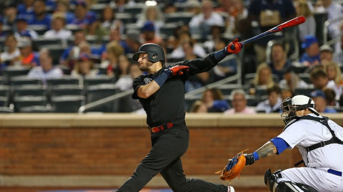 NEW YORK, NY - AUGUST 24: Josh Donaldson #20 of the Atlanta Braves hits a home run against the New York Mets during the third inning of a game at Citi Field on August 24, 2019 in New York City. Teams are wearing special color schemed uniforms with players choosing nicknames to display for Players' Weekend. (Photo by Rich Schultz/Getty Images)